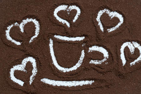 View from above. Ground coffee. Drawing of a coffee cup with aromatic smoke. Coffee love concept Stok Fotoğraf