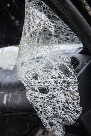 Broken car windshield close-up. Accident, downed crossings. Concept