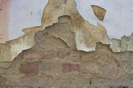 An old wall in a dilapidated house. Peeling plaster, background and texture Stok Fotoğraf