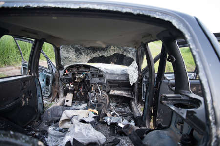 Salon of a wrecked car. The car was stolen, robbed and smashed. The thieves took off everything of value. Interior of the car. Stok Fotoğraf