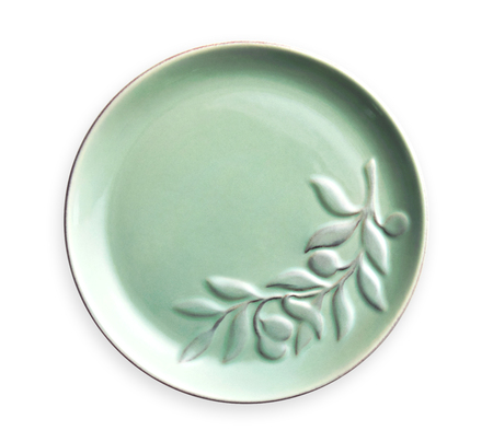 Empty ceramics plates, Green plate with floral pattern, View from above isolated on white background with clipping path