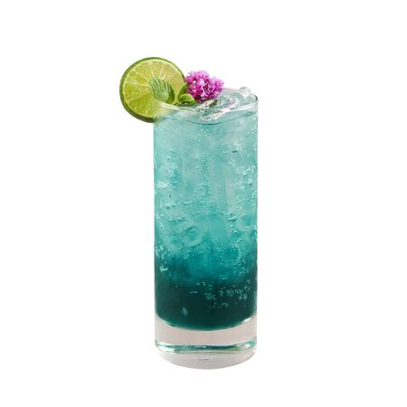 Beautiful blue color cocktail with lime slice, isolated on white background, with clipping path