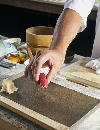 Closeup of chef hands preparing japanese food, Japanese chef making sushi at restaurant