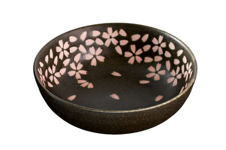 Brown ceramic bowl with Cherry blossom pattern, Empty brown bowl isolated on white background. Side view