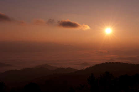 sunrise time in the mountain of pai, Thailand  photo