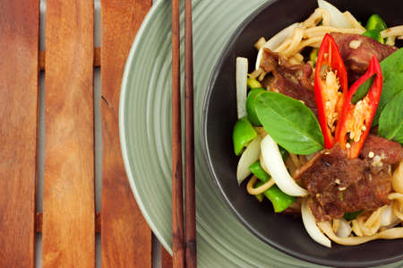 Asian fried noodle with beef photo