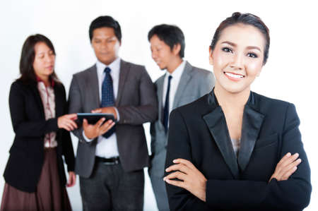 executive woman: Business team, one businesswomen and her team on background