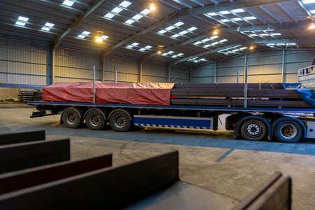 Flatbed with only the Rear Tarp covering the Load of Steel Girders Front Tarpaline to be Fitted before the Sheeting is Complete and Weatherproof.