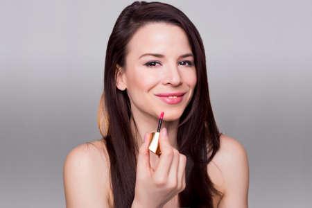 exhilaration: Pretty girl applying makeup Stock Photo