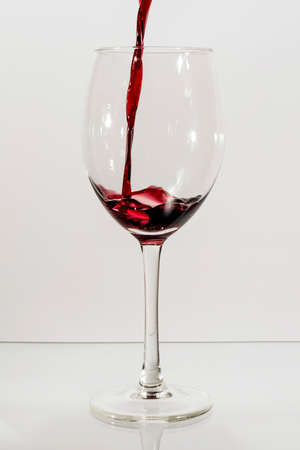 red wine pouring: Red wine pouring Stock Photo