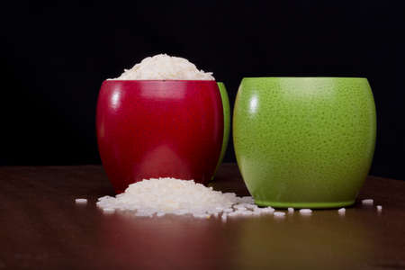 chinesse: Rice spilled in colorful bowls Stock Photo