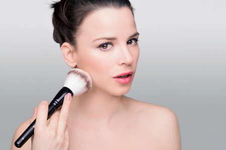 beauty shot: Beauty shot of a woman with makeup brush