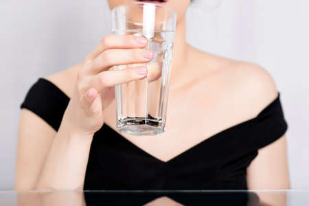 Woman drinking water from a glass