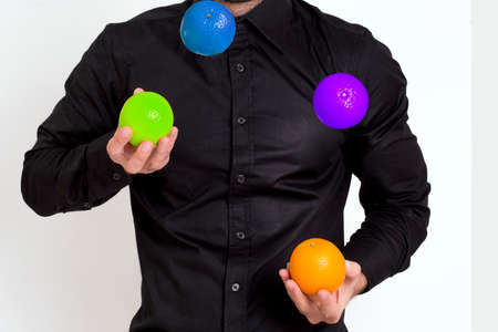 Man in black shirt joggling Stock Photo