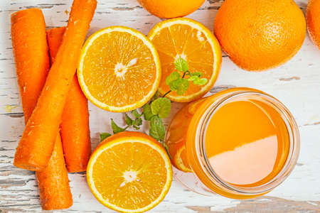 menthol: Orange and carrot juice with menthol leaf Stock Photo
