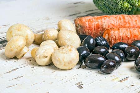 Mushrooms black olives and broccoli photo