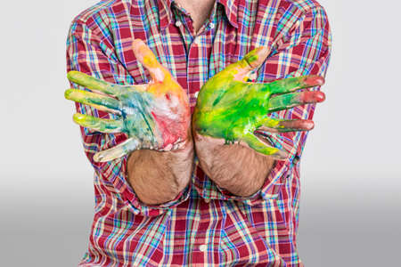 finger paint: Finger paint man on hands on a white backgorund