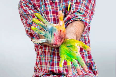finger paint: Finger paint on an adult hands Stock Photo