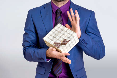 grabing: Businessman holding  a gift box