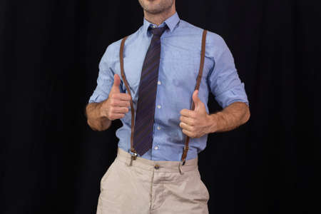grabing: Businessman with suspenders approving