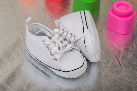 shinning: Baby shoes on shinning floor Stock Photo