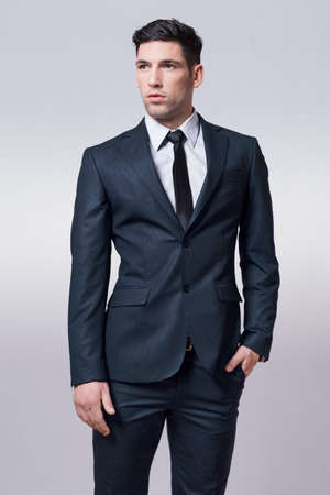 grabing: Male model posing in suit Stock Photo