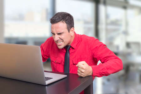 computer problem: Angry worker at the office Stock Photo