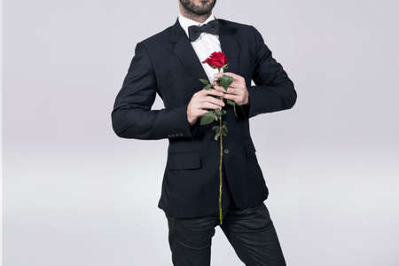 red hand: Lover holding a red rose