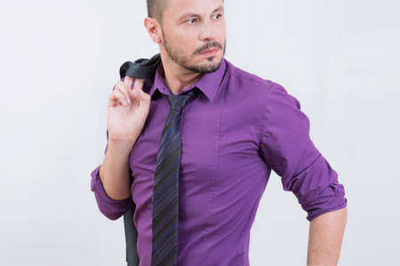 grabing: Businessman looking sideways in a purple shirt