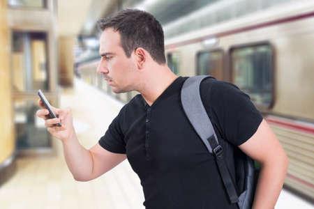 bad man: Man in hurry looking at his smart phone