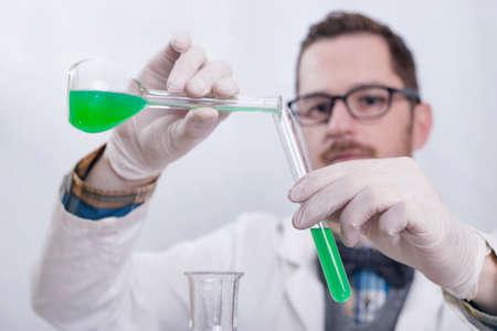 liquids: Chemist scientist pouring liquids