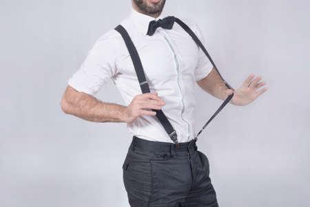 suspenders: Groomsman showing off his suspenders