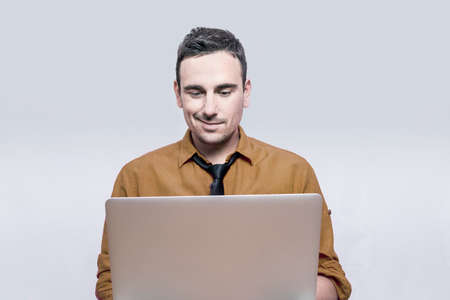 lap top: Man smiling to his lap top