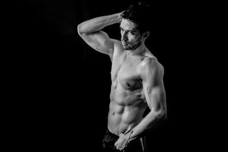 strong men: Man posing shirtless in black and white