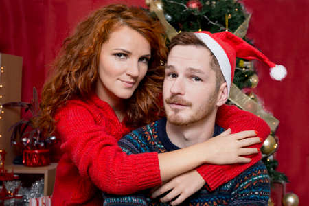portrait couple: Couple of redheads in love for Christmas