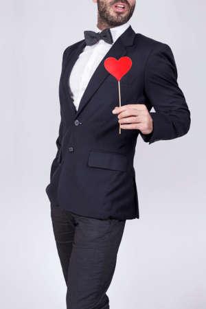 grabing: Groomsman holding a heart