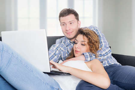 lap top: Happy couple looking at lap top Stock Photo