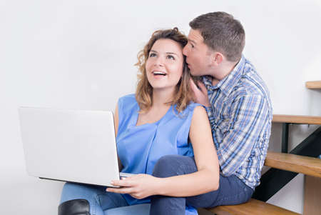lap top: Happy couple and a lap top