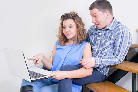 lap: Couple smiling at a lap top Stock Photo