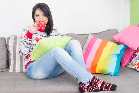 indoors: Girl drinking coffee indoors