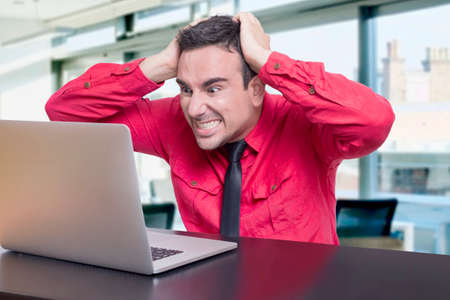 Stressed man in the office Stock Photo