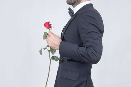 love rose: Man holding a red rose