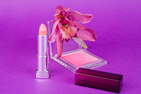 Makeup and an orchid Stock Photo