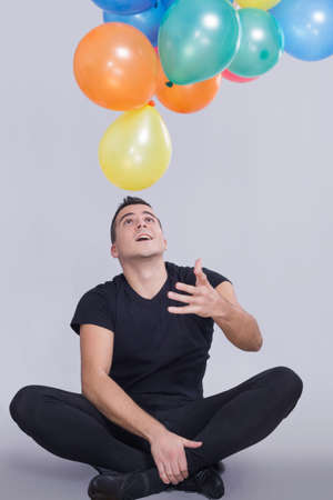 Man playing with balloons