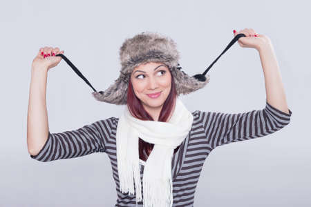 Girl wearing a hat fooling around Stock Photo