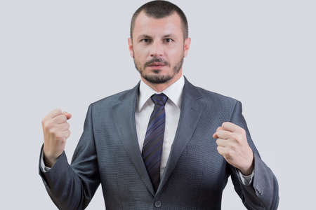 Businessman holding his fists tight
