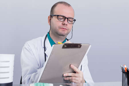 Doctor writing down