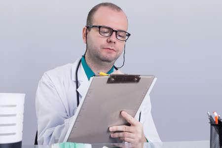 doctor writing: Doctor writing down