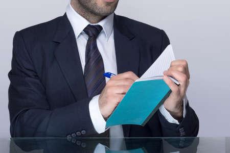 Man writing down