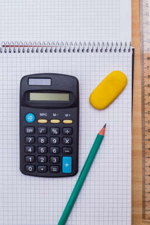 Calculator on a school table Stock Photo